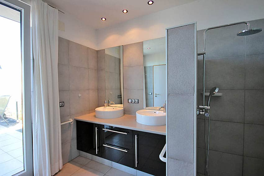 Bathroom with rain shower and double sinks
