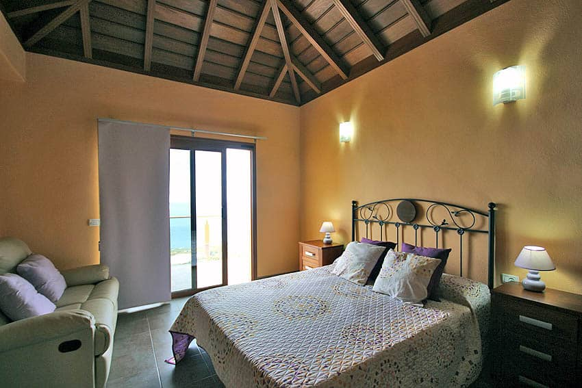 Bedroom with double bed and a small private balcony