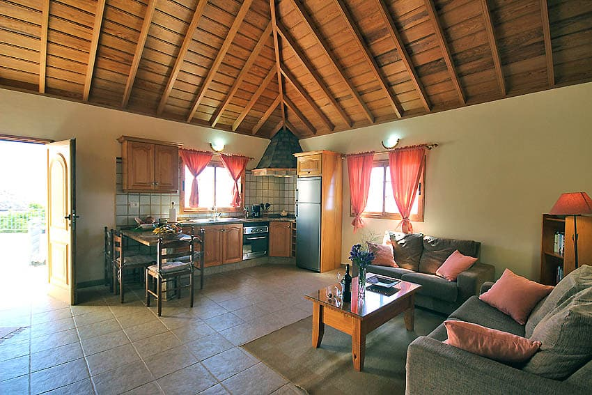Holiday Cottage with pool La Palma Casa Candelario: Romantic living area with kitchen and wooden ceiling