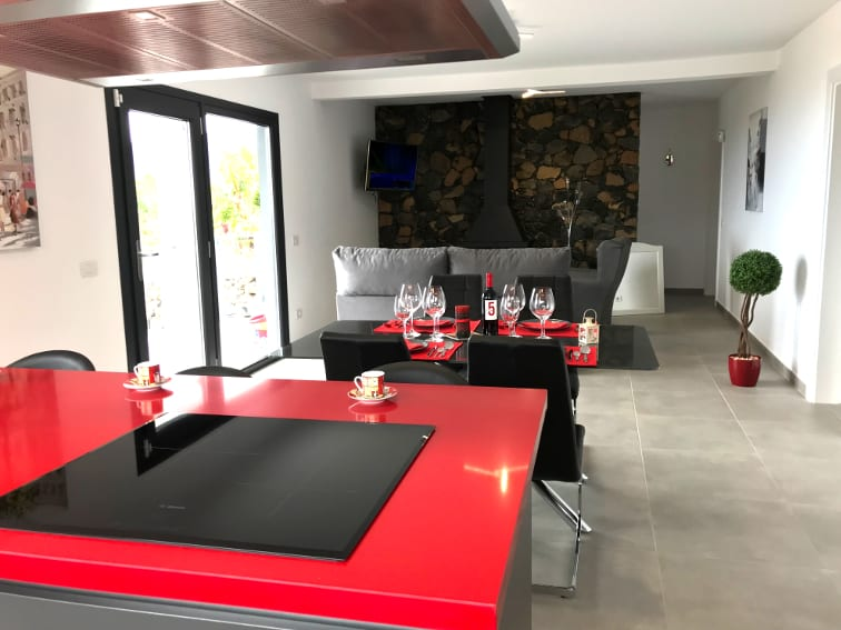 Spain - Canary Islands - La Palma - Los Llanos de Aridane - Villa La Graja - Cozy dining and living room with American kitchen and fireplace