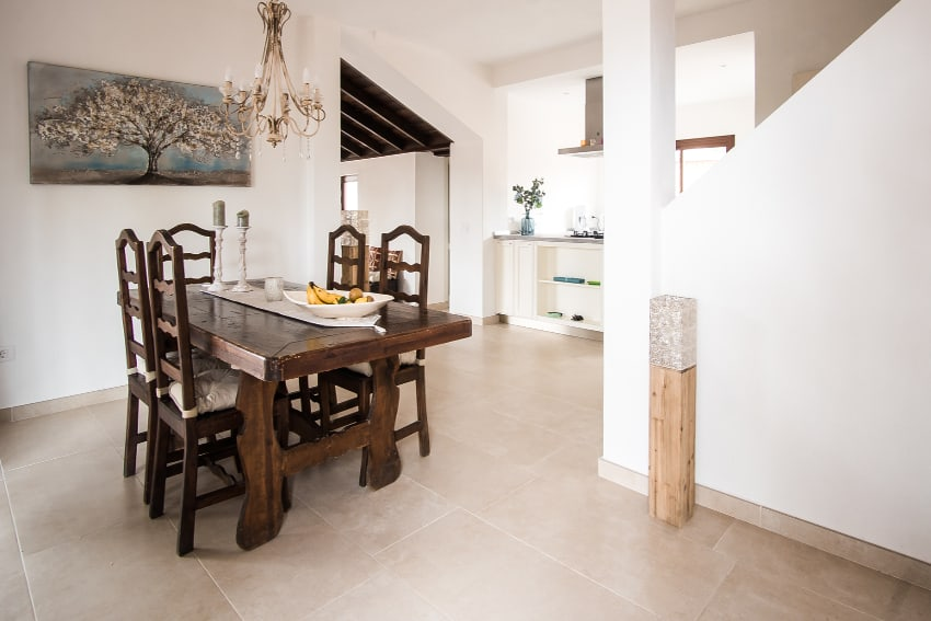 Spain - Canary Islands - La Palma - Fuencaliente - Finca Teneguía - Large dining table and view towards the kitchen