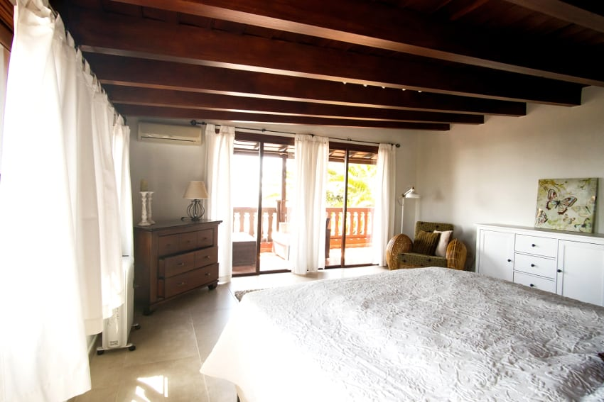 Spain - Canary Islands - La Palma - Fuencaliente - Finca Teneguía- Master bedroom on the upper floor with view towards volcano San Antonio and Teneguía