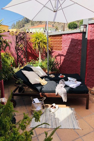 Spain - Canary Islands - La Palma - Fuencaliente - Finca Teneguía - Outdoor terrace with sunumbrella and sunbeds