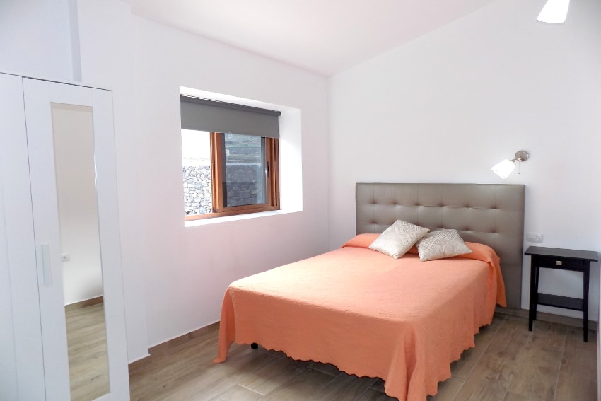 Spain - Canary Islands - El Hierro - Frontera - Villa Tejeguate - Bedroom with double bed and mountain views