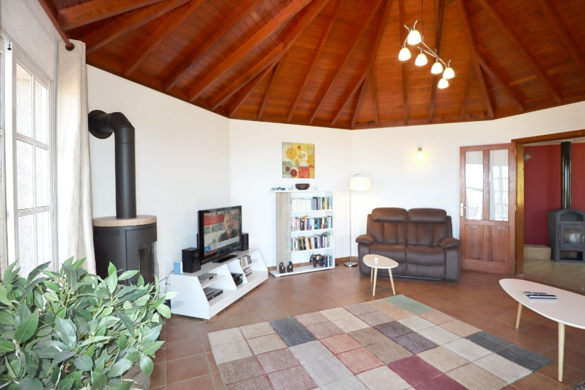 Spain - Canary Islands - La Palma - Los Llanos - Villa Panorámica - Cozy living area with fireplace and direct access to the sun terrace