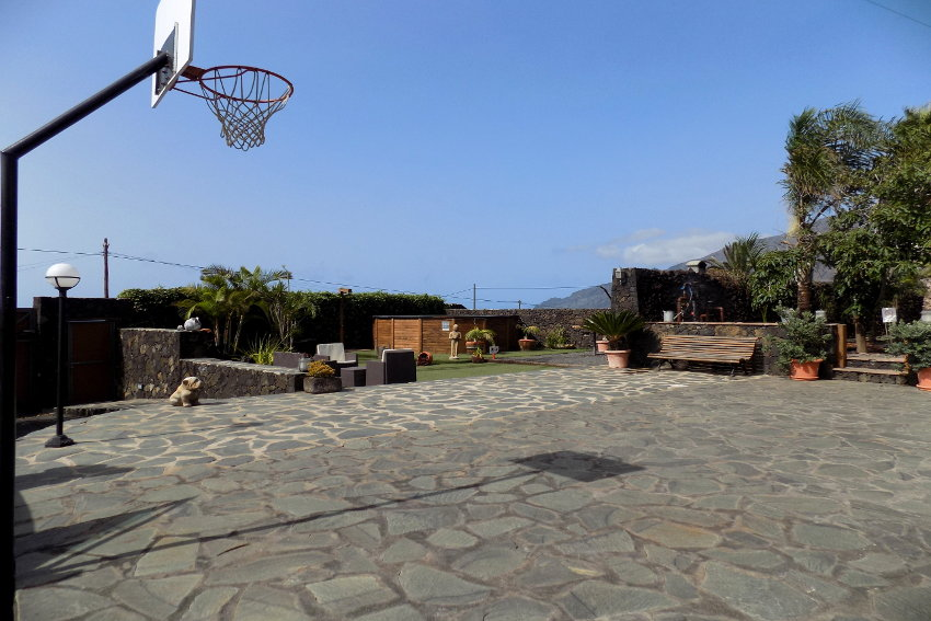 Spain - Canary Islands - El Hierro - Frontera - Finca Arteaga - Outdoor area with basketball basket and gate with electric drive